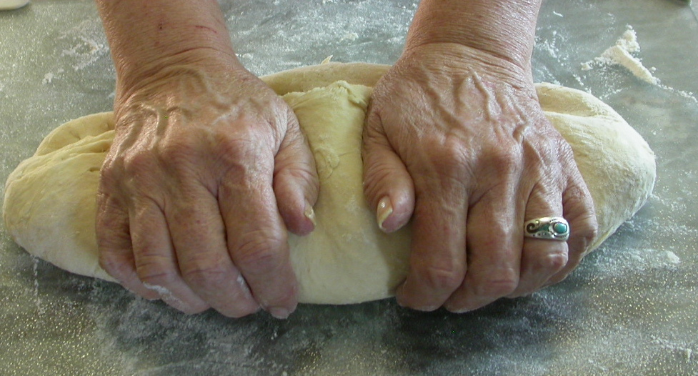 Kneading dough to bake bread from scratch.