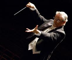 Orchestra Conductor Wields his Baton
