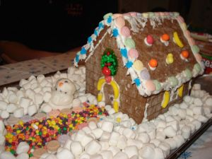 Marshmallows snow in a gingerbread house