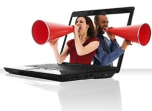 a black laptop computer with a red megaphone