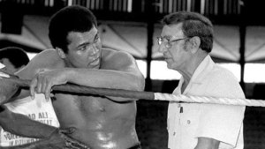 Boxing Champion Muhammd Ali consults with his trainer Gus  D'Amato
