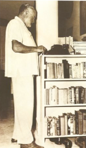 Ernest Hemingway at his stand up desk: typewriter perched atop dresser doors