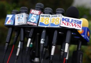 Microphones from San Diego media and news outlets are gathered for a news conference