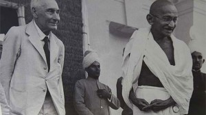 Gandhi (right) wearing his pocket watch around his waist
