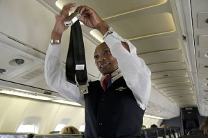 Georgia Atlanta Hartsfield International Airport Delta Airlines Black woman airline flight attendant aircraft safety demonstrati